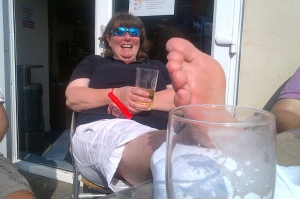 Fi icing her ankle and enjoying a purely medicinal  post Hickley Tiller refreshment on the Colne Yacht Club balcony.